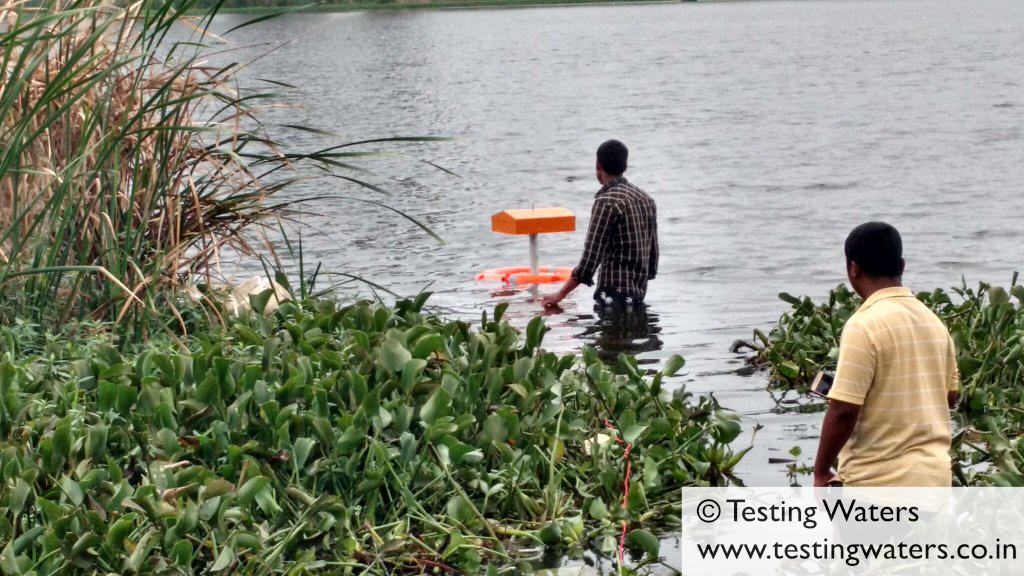 Fishermen helping us install it in the Hulimavu Lake